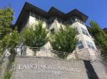 Larchmont Apartments signage